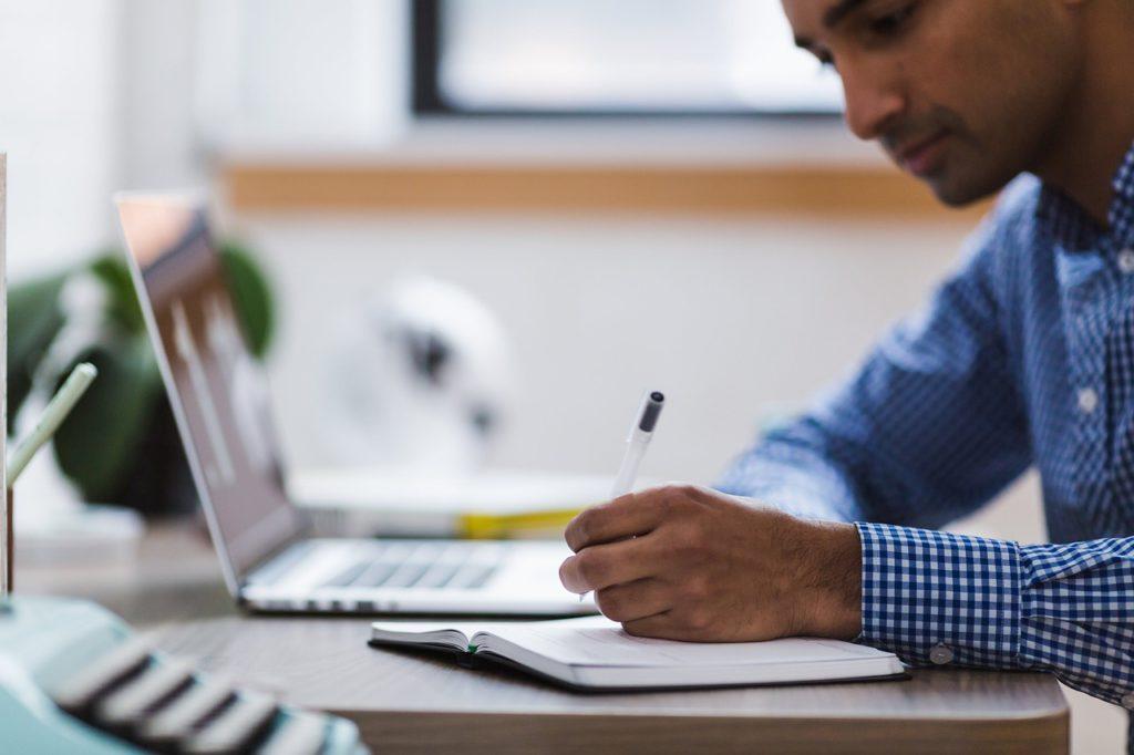 man proofreading at desk
